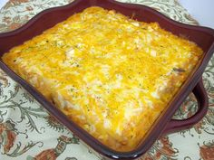 Dorito Chicken Cheese Casserole    3 cups cooked chicken, chopped (I used a rotisserie chicken)  8 oz sour cream  1 can cream of mushroom soup  1 can cream of chicken soup  1 1/2 cups salsa or 1 can Rotel  1 can of corn, drained  2 cups Mexican cheese, shredded  1 bag of nacho cheese Doritos    Preheat oven to 350 degrees.    Lightly spray a 9x13 pan with cooking spray.  Crush the entire bag of Doritos and cover the bottom of the dish.  Reserve one cup of cheese.   Mix together remaining ingr...