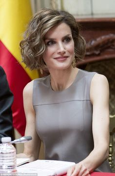 Queen Letizia takes a seat in the library, which was once a palace, was built in 1883 by architect Paul Dechard