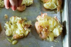 by Ree Drummond / The Pioneer Woman: boil potatoes then smash slightly on oiled baking sheet, season and put in 450 oven on top until browned