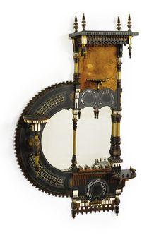 "Carlo Bugatti (1856-1940) - Mirror. Stained & Ebonized Wood, Pewter & Brass Inlays, Ivory and Leather. Circa 1900.  48-1/4"" x 26-1/2"" x 8-1/8""."