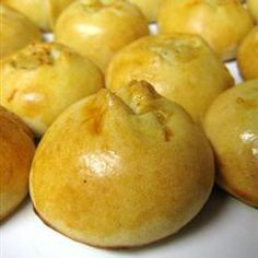 "Knish - ""Traditional Jewish treat of little golden pastry domes filled with seasoned mashed potatoes and fried onions."""