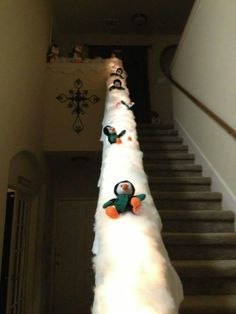 Penguin banister slide. So dang cute