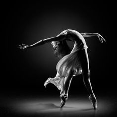 It looks like there is a spot light which gives the dancer the value.