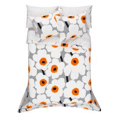 One of Marimekko's most beloved and popular patterns is now available in a neutral colorway, but with a pop of color. Maija Isola's Unikko pattern of white poppy flowers with orange centers decorates a