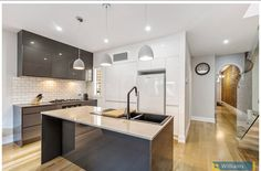 155 Ferguson St Williamstown A high quality kitchen, complete with Asko and Miele appliances and stone benchtops