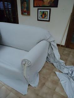Step by step of how to reupholster a couch using canvas drop cloths, courtesy of www.powellbrower.com