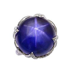 Natural star sapphire lotus ring in platinum with diamonds