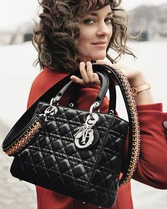 Face of the iconic 'Lady Dior' bag Marion Cotillard strolls effortlessly down the banks of the Seine carrying her emblematic cannage motif bag adorned with a crystal-embroidered strap photographed by Peter Lindbergh. by dior