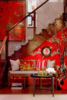 Eclectic entryway. Love the Scalamandre Zebra wallpaper in Masai red.