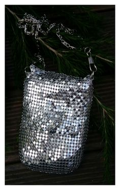 Modern mesh - mini clutch/cross body bag or soft cigarette case in  silver metal mesh. Purchased for $3.00 while op shopping.