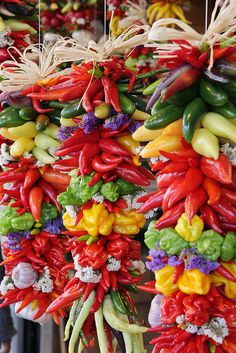 Colorful hanging pepper arrangements