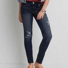 American eagle distressed jeans New American Eagle distressed skinny jeans. Size 4 regular and a darker wash. Super cute and flattering. ❌no trades. American Eagle Outfitters Jeans Skinny