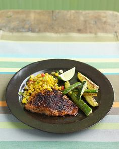 Chili-Rubbed Salmon with Zucchini and Sauteed Corn. Made this for dinner last night, It was really good! Very quick and easy too. I used skin-on salmon, canned corn, and natural salsa from a jar (because Andy, my hubby, is allergic to raw tomatoes), also squeezed the lime garnish on top of the fish and salsa...it was YUMMY!