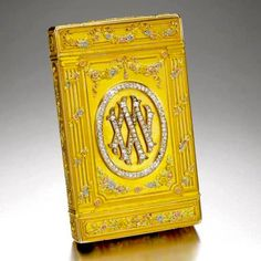 The 25th Wedding Anniversary: A Fabergé Imperial jewelled four-colour gold and diamond set cipher cigarette case given to Empress Alexandra from Emperor Nicholas II, workmaster August Holmström, St Petersburg, 1899.