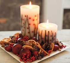 Decorate candle trays with seasonals, like dried orange slices, pine cones, nuts, berries etc.