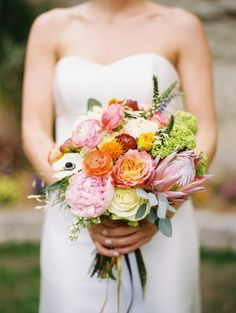#peony #protea #ranunculus Photography by ryanrayphoto.com Event Coordination by eventsbykristin.net/ Floral Design by stemsofdallas.com/  Read more - http://www.stylemepretty.com/2013/07/01/backyard-dallas-wedding-from-ryan-ray-photography/