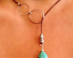 Hate clasps? Me too!! Ive worn lariat necklaces for years because theyre easy to wear. No clasps to spin around or struggle to fasten. Intersecting sterling silver 1 teardrop hoops dangle a quartz crystal point to complete this earthy, feminine look. If youre a Free People lariat and/or choker lover, youll enjoy this sexy gem. Never out of style. Sterling silver loops with either black or brown waxed linen cord.