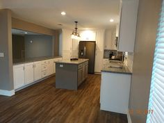 13245 Virginia Ln Willis, TX 77318: Photo Custom Kitchen with Island, White Shaker Cabinets and Complete GE Appliance Package. Island Has Pull Out Storage to Accommodate Double Trash Cans.