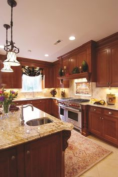 color idea for replacing countertop to my cherry kitchen -  Roman Gold Granite