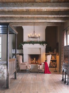 Great fireplace, chest and chandelier