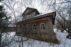 Another abandoned wooden cottage in the Yaroslavl region of Russia. There are…