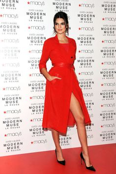 The model celebrates the launch of the new Estee Lauder fragrance, Modern Muse Le Rouge, wearing a scarlet-hued trench dress.