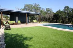 Synthetic grass compliments a pool and kids.
