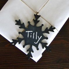 *Chalkboard paint + those cheap paint-it-yourself wooden Christmas ornaments at craft stores = a gift tag that works again and again.