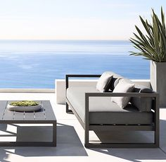 "RH's 123"" Aegean Aluminum Sofa:Influenced by the low, linear silhouettes of seaside architecture, our contemporary collection is designed by a family-owned company in Australia known for its meticulous metalwork. Its superior materials and simple geometry enable it to weather the elements in enduring style."