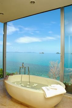 beautiful freestanding tub overlooking the ocean -- 6 Beautiful  Luxurious Bathrooms from Pinterest from Bathroom Bliss by Rotator Rod