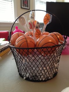 Found these cute baskets at the Dollar Tree and thought they looked like basketball nets. Was supposed to have big bouquet of NC State balloons tied to it, but the wind didn't allow it. In the basketballs were assorted ball chocolates.