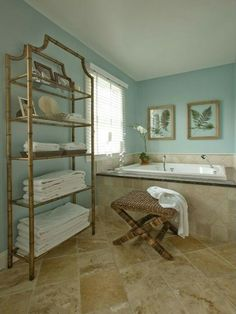 Robins egg blue aqua bathroom, travertine floor, window, bamboo shelves