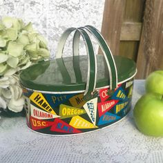 Antique Decorative Tin box  Basket Lunch Pail, College Sports Pennant, Picnic, Mid Century, canister / oval round w/ handles.