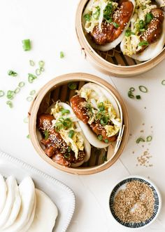 Combining sweet and savory sesame chicken with cloud-like gua bao was one of our best ideas to date. Try it for yourself with our recipe and instructions! Gua Bao, Sesame Chicken, Fried Chicken, Wok, Steamed Bao Buns, Bo Bun, Asian Recipes, Ethnic Recipes, Asian Foods