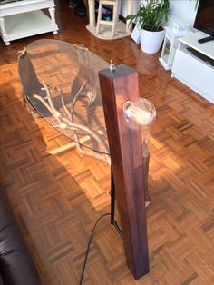 Recycled walnut timber and steel floor lamp with palm tree and eucalyptus coffee table #theonlyonesymmetry
