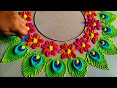 peacock feathers rangoli for Diwali Lakshmi Pooja Rangoli Designs Simple Diwali, Rangoli Designs Peacock, Indian Rangoli Designs, Rangoli Designs Latest, Free Hand Rangoli Design, Rangoli Border Designs, Small Rangoli Design, Rangoli Patterns, Colorful Rangoli Designs
