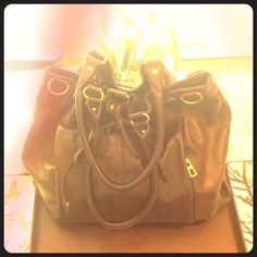 I just discovered this while shopping on Poshmark: Authentic BCBJ brown leather bag. Check it out! Price: $21 Size: OS, listed by rachelle03