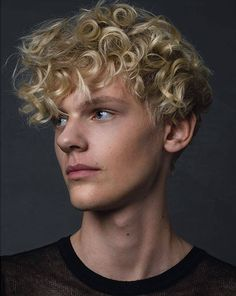 Sums has hair like this- curly and light blonde. He has blue eyes and wears glasses but is significantly chubbier than this.