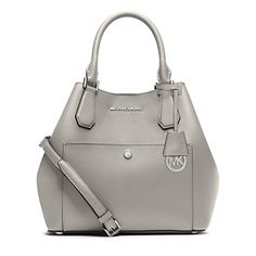 Crafted in fine Saffiano leather, this MICHAEL Michael Kors bag creates a modern look with its cinched shape and spacious, unlined interior. Saffiano leather Double handles with 5' drop; adjustable sh...
