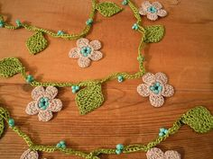 crochet necklace lariat cream flower green leaves by PashaBodrum
