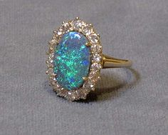 Black Opal and Diamond Oval Ring...(reminds me of the ring I received at Graduation) ♥
