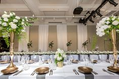 Long Tables in the Isabella Fraser Room at the State Library Victoria with beautiful centrepieces by Bouquet Melbourne, table settings and furniture by Dann Event Hire