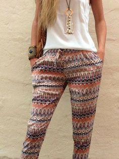 Love the patterned zig zag trousers with the White top