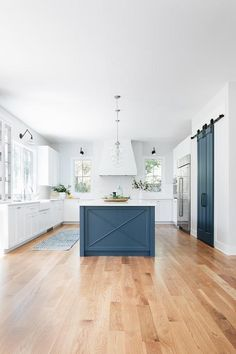Blue and white kitchen featuring a blue island with x trim and glass globe pendants. Blue Kitchen Island, Blue Kitchen Cabinets, White Shaker Cabinets, Painted Kitchen Island, Kitchen Islands, Kitchen Island Different Colour, Barn Kitchen, Kitchen Decor, Kitchen Design