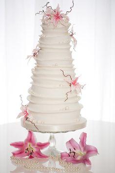 Pink sugar lilies & pearls ... unusual striking cake