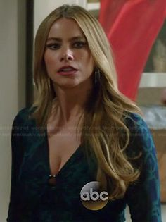 Gloria's blue and green snake print top on Modern Family.  Outfit Details: http://wornontv.net/38888/ #ModernFamily