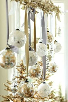 holiday inspiration to throw the ultimate christmas soiree hang ornaments from metallic ribbons and garland for a festive flair