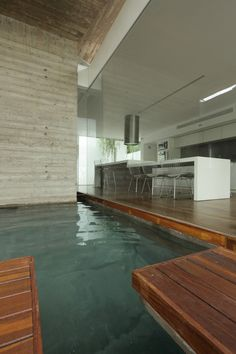 Bunker House by Estudio Botteri-Connell with indoor/outdoor pool #swimmingpool