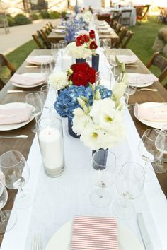 Loved these groupings of red, white and blue flowers against the white table cloth.