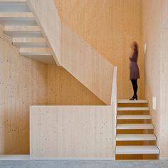 Panels of cross-laminated pine form an angular staircase at the heart of this five-storey townhouse in Amsterdam by local studio MAATworks. The all-pine finishes are intended to lend the interior the appearance of having been carved from wood. Find out more on dezeen.com/architecture #architecture #house #stairs #Amsterdam Photograph by Marcel van der Burg.
